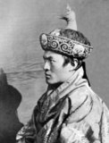 The Druk Gyalpo (Dzongkha: འབྲུག་རྒྱལ་པོ་; Wylie: brug rgyal-po; 'Dragon King') is the head of state of Bhutan. He is also known in English as the King of Bhutan. Bhutan, in the local Dzongkha language, is known as Dryukyul which translates as 'The Land of Dragons'. Thus, while Kings of Bhutan are known as Druk Gyalpo ('Dragon King'), the Bhutanese people call themselves the Drukpa, meaning 'Dragon people'.<br/><br/>  The current ruler of Bhutan is the 5th Hereditary King His Majesty Jigme Khesar Namgyel Wangchuck, who is the 5th Druk Gyalpo. He wears the Raven Crown which is the official Crown worn by the Monarchs of Bhutan. He is correctly styled 'Mi'wang 'Ngada Rimboche' ('His Majesty') and addressed ''Ngada Rimboche' ('Your Majesty').